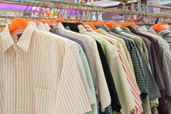 Clothes shop. Men's shirt hanging in a clothing store Stock Images