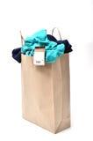 Clothes in a shopping bag Stock Photos