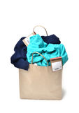 Clothes in a shopping bag Stock Images