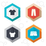 Clothes signs. T-shirt and pants with shorts Royalty Free Stock Photography