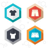 Clothes signs. T-shirt and pants with shorts Stock Photography