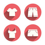 Clothes signs. T-shirt and pants with shorts Stock Photo