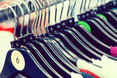 Clothes sizes on hangers Royalty Free Stock Images