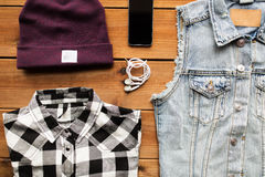 Clothes and smartphone with earphones Stock Images