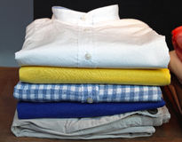 Clothes. Stack of clean modern clothes Stock Image
