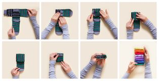 Clothes storage. Order in the closet. Folding socks. Master Clas Stock Photos