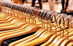 Clothes store - hangers Stock Images