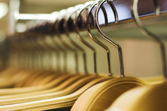 Clothes store - hangers stock image