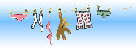 Clothes and teddy bear handing to dry Stock Photo