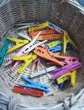 Clothes tweezers. Close up view of some Clothes tweezers inside a basket stock photo