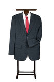Clothes Valet Butler Coat Suit Garment Stand with business suit. Traditional hotel style clothes stand with suit, collar and tie. Business uniform, slightly Stock Images