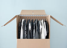 Clothes in a wardrobe box for easy moving Royalty Free Stock Image