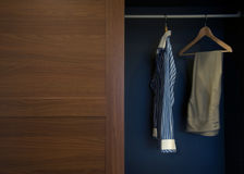 Clothes in wardrobe wood Stock Photos