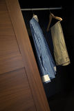 Clothes in wardrobe wood Royalty Free Stock Image