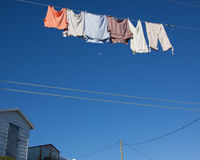 Clothes on washing line. Low angle view of clothes or laundry on washing line with blue sky background Stock Photography