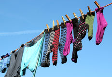 Clothes on a washing line. Clothes on a washing line with a blue sky background Royalty Free Stock Images