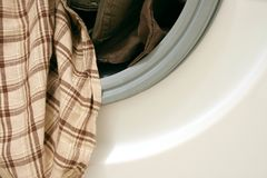 Clothes in washing machine stock photo