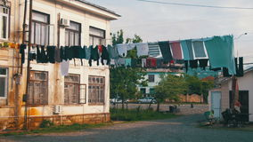 Clothes Weigh and Dry on a Rope in a Multi-Storey Building in a Poor Neighborhood of the City. Slums, old high-rise buildings in Batumi, Georgia stock footage