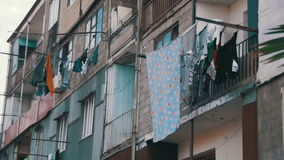 Clothes Weigh and Dry on a Rope in a Multi-Storey Building in a Poor Neighborhood of the City. Slow Motion