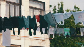 Clothes Weigh and Dry on a Rope in a Multi-Storey Building in a Poor Neighborhood of the City. Slums, old high-rise buildings in Batumi, Georgia stock video