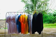 Clothes were hung on an iron railing. Clothes are cleaned after being worn, which can be dried in the sun to dry and disinfect some way, naturally stock photography