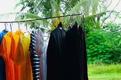 Clothes were hung on an iron railing. Clothes are cleaned after being worn, which can be dried in the sun to dry and disinfect some way, naturally stock photos