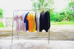 Clothes were hung on an iron railing. Clothes are cleaned after being worn, which can be dried in the sun to dry and disinfect some way, naturally stock image