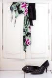 Clothes on white closet Stock Image