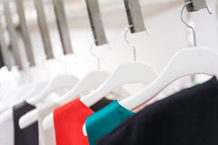 Clothes in white showroom Stock Photography