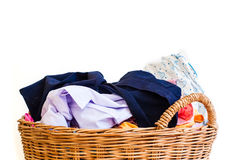 Clothes in wicker basket on white background Royalty Free Stock Image