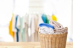Clothes in wicker basket on wooden table at laundry. Clothes in wicker basket on wooden table at laundry-Household chore concept royalty free stock photos