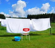 Clothes in the wind. Linen on a clothesline during a sunny washday Royalty Free Stock Photo