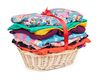 Clothes in a wooden basket on isolated white background royalty free stock images