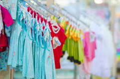 Clothes for young babies in kids mall Royalty Free Stock Images