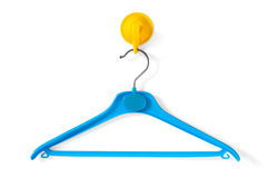 Clotheshanger. Blue clotheshanger hanged on a yellow one Stock Images
