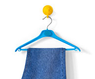 Clotheshanger With Blue Jeans Royalty Free Stock Photos