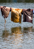 Clothesline. Wet shirts hanging over water Stock Image