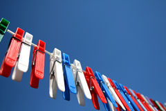 Clothesline. With pegs in a sunny garden royalty free stock images