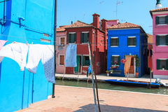 Clothesline at blue facade in Burano, Venice Stock Photos