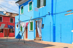 Clothesline at blue facade in Burano, Venice Royalty Free Stock Photo