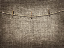 Clothesline with clothespins on linen background Royalty Free Stock Photos
