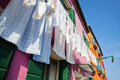 Clothesline in front of colorful houses in Burano Royalty Free Stock Photos
