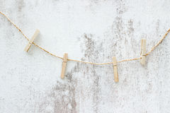 Clothesline with line on grunge wall. Picture stock photography