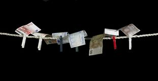 Clothesline and money Stock Image