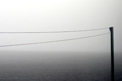 Clothesline in morning fog stock images