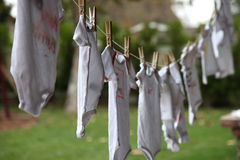 Clothesline of onesies Royalty Free Stock Images