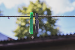 The clothesline pinned to different colors clamps Stock Photography