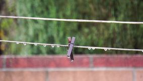 Clothesline in a rainy day. With water drops at Temple City, Los Angeles, California, U.S.A stock video footage