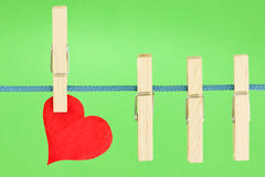 Clothesline with a red heart stock image