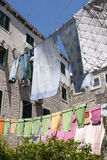 Clothesline between stone houses Stock Images
